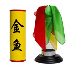 Several colorful silks are placed into the Crystal Silk Cylinder.The Cylinder is then covered with a yellow tube and then quickly removed,the silks have disappeared with the Cylinder now full of balls, candy or even live gold fish.