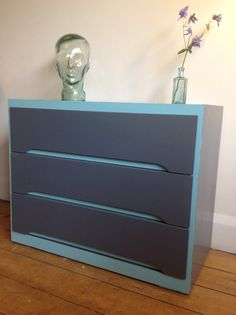 A vintage three drawer chest, hand stripped and painted. Block colour of slate grey with teal accents to highlight the design. The drawers are 76cm wide, 38cm deep and 60cm high | £50 | Recycled by Jessica