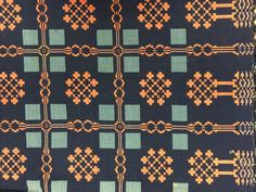 Coverlet; wool double-weave in dark blue, light blue, and madder-red, woven in 2 pieces and joined lengthwise. Design features a snowflake motif at the center of a delicately drawn madder square lattice, very fine weave. c. 1830 American Textile History Museum in Lowell, Massachusetts
