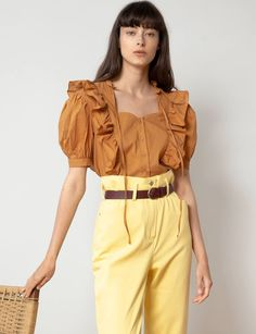 This sweet burnt brown color shirt with ruffles, puff shorts sleeves & collar ties is great with a skirt, pants, or even shorts. Shop the look at Pixie Market. Colourful Outfits, Trendy Outfits, Blouse Models, Boho Tops, Ruffle Top, Fashion 2020, Blouse Designs, Blouses For Women, Plus Size Fashion
