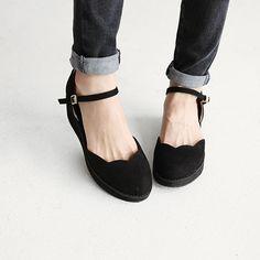 scallop strap shoes.