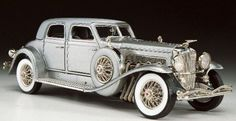 "Considered to be the most luxurious Duesenberg ever, the world knew it as the ""20 Grand"" because it had the bold price tag of $20,000 back in 1933. First seen and built exclusively for the Chicago World's Fair, it's value today would be in the millions. This replica has been handcrafted out of 148 separate parts and is authentic down to the smallest detail. From the Duesenberg hood ornament to the genuine instrument panels, it's been painted a beautiful champagne silver by th"