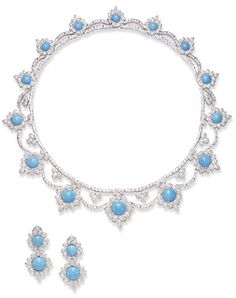 AN ATTRACTIVE SUITE OF TURQUOISE AND DIAMOND JEWELRY  Comprising a necklace, the circular-cut diamond flexible line suspending a graduated fringe of circular turquoise, each within a circular-cut diamond frame, joined by circular-cut diamond swags, further enhanced at the front by pavé-set diamond trefoil spacers; and a pair of ear clips en suite, mounted in white gold, necklace 16 ins.