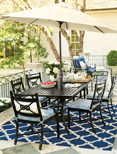 This nautical inspired patio features our Newport Patio Collection inspired by seafaring knots and a preppy navy-and-white color palette.