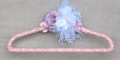 wedding dress hanger pink pink lace feathers silk and by poshweddingday.com