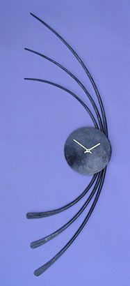 sculptural wall hanginging clock in forged metal, a modern wall clock