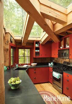 Love This Kitchen. Amazing Glass Ceiling mixed in with the rustic beams. Love the pop of red on the cabinets!