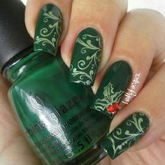 Pinned by www.SimpleNailArtTips.com CHRISTMAS NAIL ART DESIGN IDEAS - stamped filigree and holly over forest green