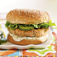 Skip the beef and serve a Mexican-inspired salmon burger topped with a fresh lime-cilantro mayonnaise sauce. Cook the salmon patties in a skillet to enjoy this hearty burger year-round. A spinach salad with a sweet, slightly spicy Asian-influenced dressing makes a tasty accompaniment.