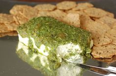 "This is the ""pot luck event"" time of year so let's talk appetizers. Below you'll find a recipe for a super easy and insanely popular ""Pesto Cream Cheese Ba"