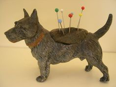 Love this pin cushion.not sure I would want to store pins in it .Kind of like a voodoo dog.