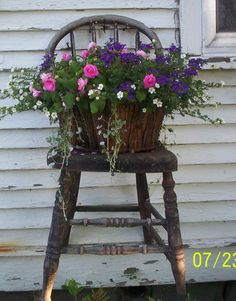 old chair hung as planter shelf.....mine By L. Turner