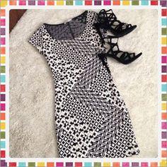 🎀 Black & White Dress! Never worn. Mini dress. Veryyyyy fitting/runs small. Black & white design all over dress. Short sleeves. (Just dress is for sale) Charlotte Russe Dresses Mini