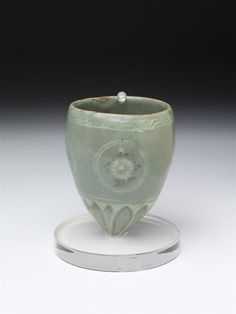 Cup      Place of origin:      Korea (made)     Date:      1200-1300 (made)     Artist/Maker:      Unknown (production)     Materials and Techniques:      Stoneware, inlaid with black and white slips under a celadon glaze     Credit Line:      Purchased with the assistance of The Art Fund, the Vallentin Bequest, Sir Percival David and the Universities China Committee