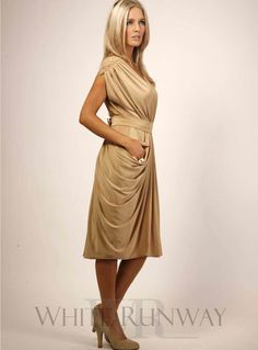 Allana Dress. A cocktail length dress by designer Pia Gladys Perey. The Allana features a deep plunging neckline on the back and can be worn back to front.