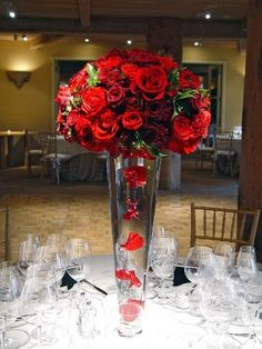 Red Import Roses create stunning overhead centerpeice with floating petals