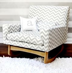 """nursery rocker in a grey chevron pattern - would definitely love to have a modern yet cozy-squishy rocking chair in the future nursery! and a cute pillow. this one is """"only"""" 700... hahaha."""