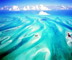The sand and the sea create art in the Exumas. #Bahamas #Travel