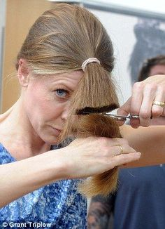 Carefully does it: Alice puts her hair into a ponytail, measures, left, and then cuts and snips her ends with a pair of scissors