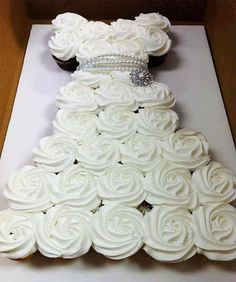 Cupcake Wedding Dress Wedding Cake  A wedding cake in the shape of a white wedding dress.  The form is made out of cupcakes.