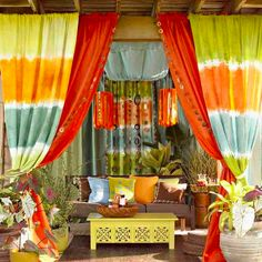 Long, flowing draperies aren't just for your living room. Outdoor curtains instantly soften what's sometimes all an all-concrete or all-wood patio space—and psst, they can hide unattractive items like electrical boxes or storage bins, too. With more sun-ready fabrics than ever on the market, why not bring out curtains with a burst of color too? Outdoor fabric dedicated companies like Sunbrella carry a huge variety.