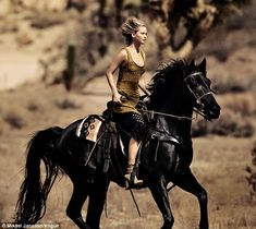 Even cowgirls get the blues: Jennifer, who is pictured here in the new shoot for Vogue, has revealed she's struggling to find Mr Right