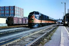 "IC ""City of New Orleans"" E-7 #4017 races through Kankakee IL, in August 1964. M. White collection."