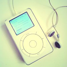 1st gen iPod with iconic white earphone.