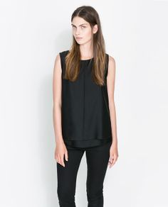 love that top. this girls almost unibrow is freaking me out. ZARA - WOMAN - SLEEVELESS BLOUSE