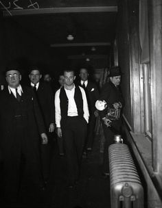 John Dillinger robbed 24 banks and four police stations and escaped from jail twice. This is Dillinger being led through the court building at Crown Point, on Jan. 31, 1934, where he was on trial for the First National Bank robbery that occurred on Jan. 15, 1934 in East Chicago