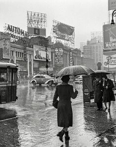 March 1943. New York, New York. Times Square on a rainy day.