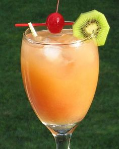 1 oz. Vodka 1 oz. Peach Schnapps 3 oz. Orange Juice 3 oz. Cranberry Juice Cherry and/or Slice of fruit to garnish