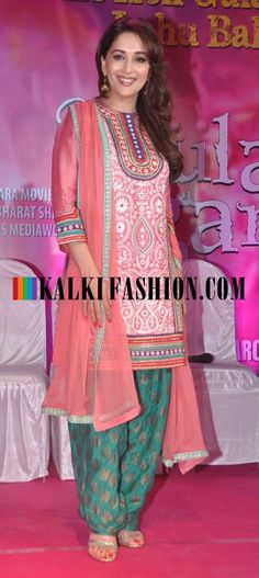 Madhuri Dixit in a pink embroidered suit.
