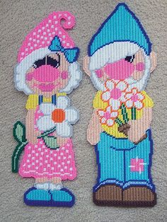 "Plastic Canvas - Garden Gnomes Gabe And Gertie. 8"" x 21"" each. On ePatterns Central."