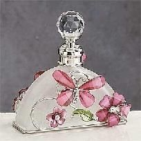Papillon rose on a clear glass perfume bottle.
