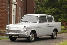Vintage Trucks FORD ANGLIA the car like this that I almost got killed in while on duty with the army in France Classic Cars British, Ford Classic Cars, Classic Chevy Trucks, Ford Lincoln Mercury, Ford Motor Company, Ford Anglia, 1964 Ford, Vintage Trucks, Funny Vintage