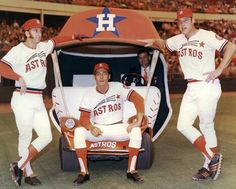 Tommy Helms, Jimmy Stewart and Johnny Edwards show off the Astros bullpen car around 1972.