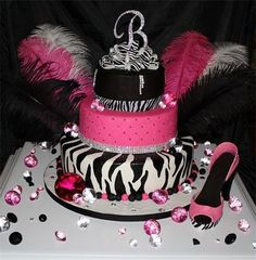 """""""Glitz and Glamour"""" Sweet Sixteen : Three tier fondant covered cake with hand-painted zebra, cross-hatching, hand made custom gumpaste shoe ostrich plumes zebra bow and Swarovski crystal B"""