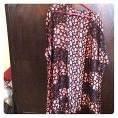 *REDUCED PRICE* Floral Kimono This kimono from wet seal has a floral pattern with lace patches. I only wore it once. Has no tears, rips, anything. The sides have slits that go to the bottom starting just below the sleeves. Wet Seal Tops