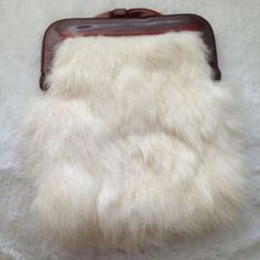 Rabbit Bunny Fur Wallet Bought it in San Felipe, never used. I do believe it's real fur because it does shed. And it may be a bit tricky to open but it's all good (: Accessories