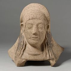 Terracotta protome of a woman    Period:      Archaic  Date:      ca. 500 B.C.  Culture:      Etruscan  Medium:      Terracotta  Dimensions:      Overall: 9 1/2 x 9 1/2 x 4 1/2in. (24.1 x 24.1 x 11.4cm)  Classification:      Terracottas