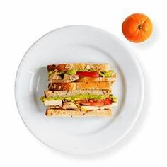 Roast chicken, avacado & tomato sandwich.  INGREDIENTS 2 slices multigrain bread (toasted tastes delicious) 1/4 ripe avocado 3 ounces cooked boneless, skinless chicken breast, sliced (rotisserie chicken, works well too) 2 slices tomato