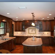 Dark cabinets with terra cotta tile floor