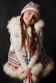 Girls knitted coat with fur collar, folk style.