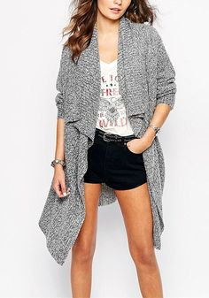 Girl in grey drape cardigan, printed top and black shorts