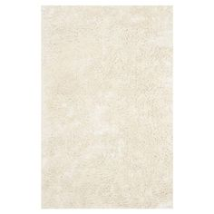 Highlighted by a rich shag pile, this hand-tufted rug brings a touch of luxe appeal to your floors.   Product: RugConstr...