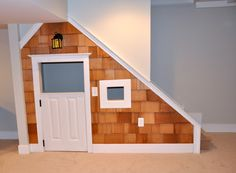 Under the stairs play area. Add a mailbox.
