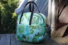This is the lovely Liesl Made Weekender Bag. A free intermediate PDF sewing pattern and tutorial is available for this bag that can be used as a diaper bag, gym bag, overnight, sleepover, or carry…
