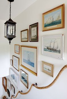 Add interest to your stairway with a rope banister and art gallery