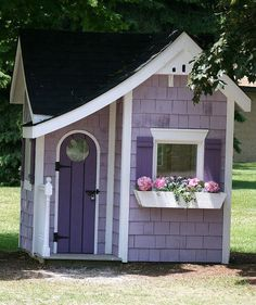 Sweet little purple play house with a bird house in the peak of the roof Girls Playhouse, Playhouse Outdoor, Painted Playhouse, Playhouse Plans, Cubby Houses, Play Houses, Wendy House, Purple Home, Little Houses